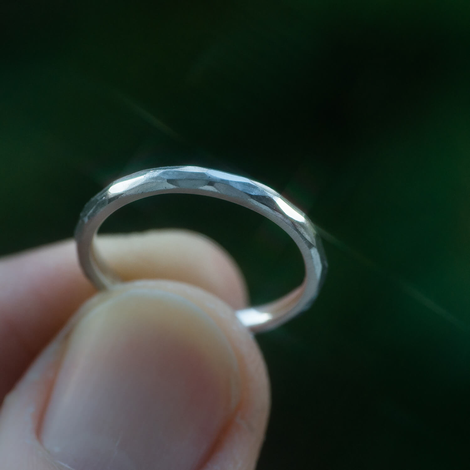 2.0mm platinum wedding ring with hammered texture, in the green of Yakushima Island